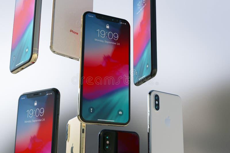 IPhonexs Gouden, Zilveren en Ruimte Grijze smartphones, het drijven verticaal royalty-vrije stock afbeelding