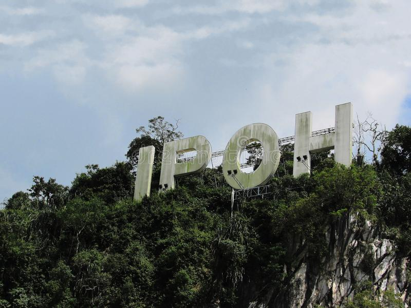Ipoh City Signage Atop A Limestone Hill. The iconic 20 metre high Ipoh city signage at Jalan Kuala Kangsar royalty free stock photography