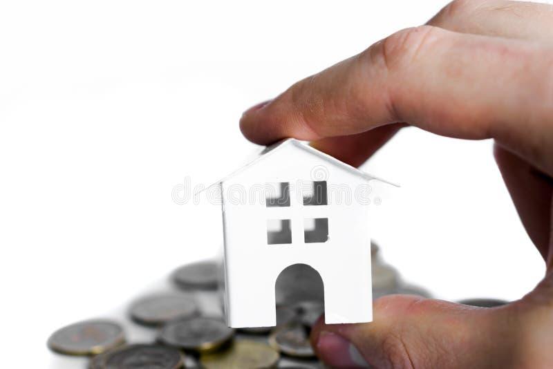 Ipotechi il concetto dalla casa dei soldi dalle monete immagini stock