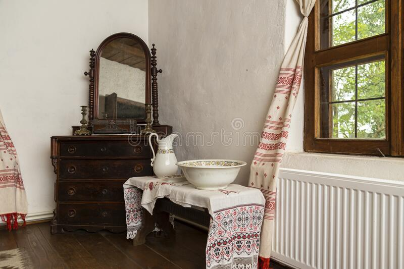 IPOTESTI,ROMANIA -AUGUST 14,2017, Inside museum house of Mihai Eminescu, Romania`s greatest writer and poet in Ipotesti village. Near Botosani city stock photo