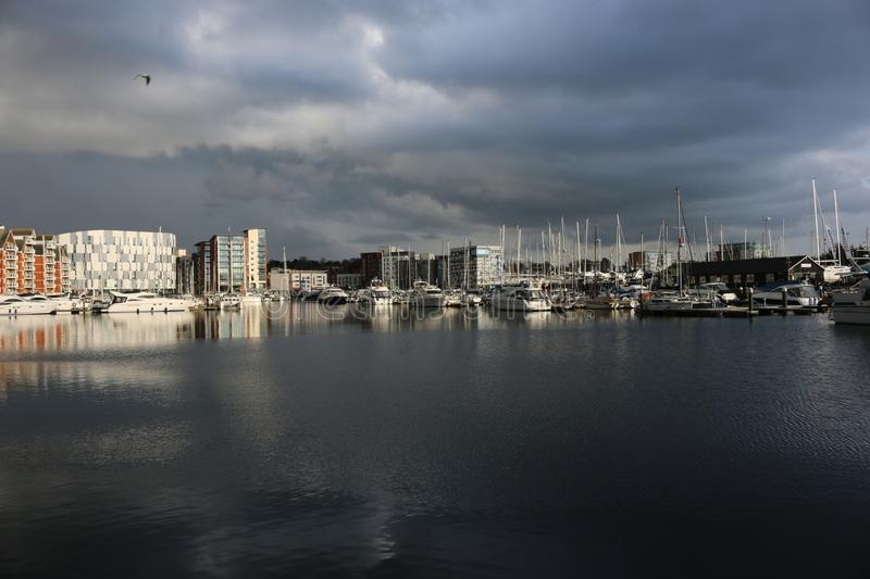 Ipswich waterfront marina with storm clouds. Waterfront marina and surrounding buildings in Ipswich, Suffolk, United Kingdom with very dark storm clouds and royalty free stock photography