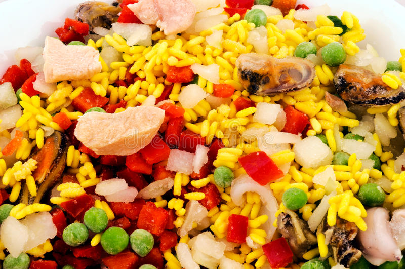 IQF food. Frozen Paella for the preparing stock photo