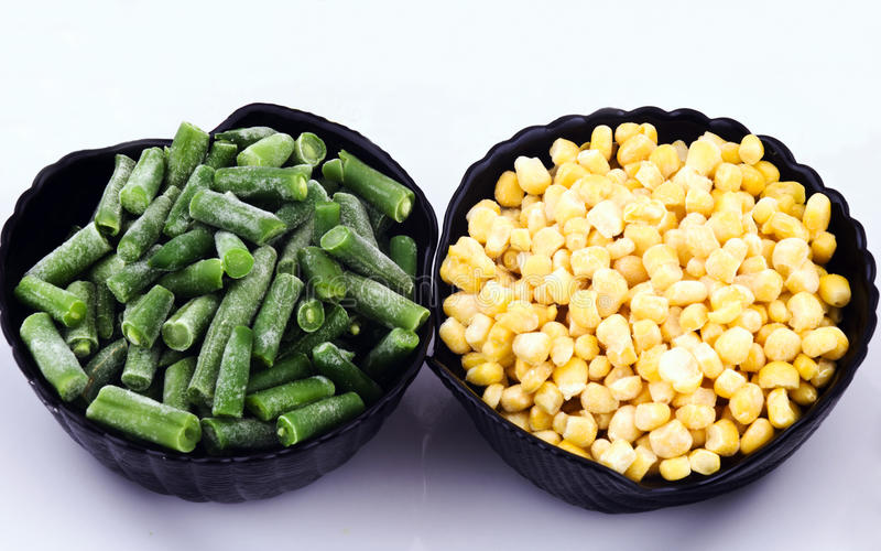 IQF Vegetables. Iqf corn and beans in black cups stock photos