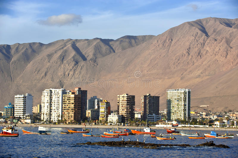 Iquique behind a huge dune, northern Chile. Pacific coast, west of the Atacama Desert and the Pampa del Tamarugal stock photo