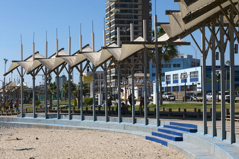 Iquique, Chile. FEBRUARY 10, 2015: Partly shaded sitting area along the Pacific coast on February 10, 2015 in . Iquique is a popular beach town and free port royalty free stock image