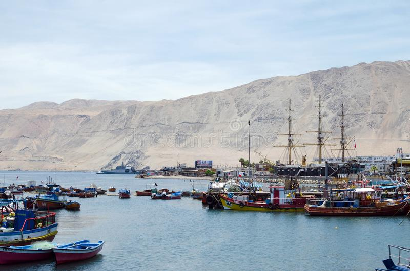 IQUIQUE, CHILE, 2017-01-18: view to the city port with fisherman royalty free stock photography