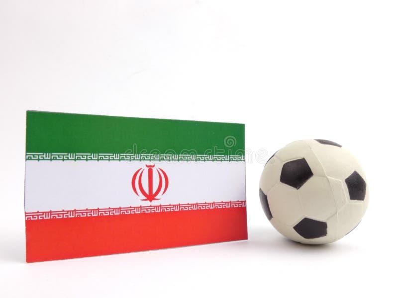 Irańczyk flaga z futbolową piłką isloated na bielu obraz royalty free