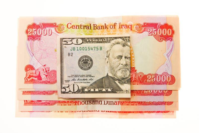 Irakiska dinar och amerikansk dollar arkivbild
