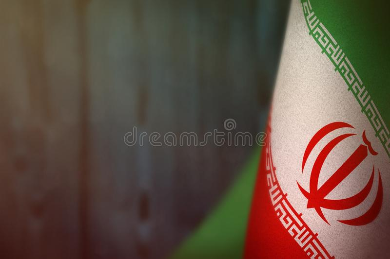 Iran flag for honour of veterans day or memorial day. Glory to the Iran heroes of war concept on light blue blurred natural wood. Iran hanging flag for honour of royalty free stock photography
