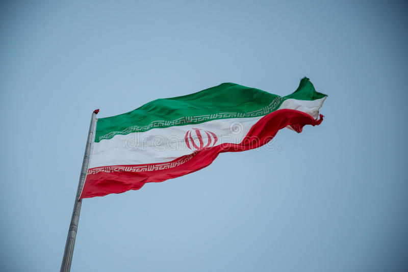 Iran flag. A Mausoleum is set south of Tehran, Iran royalty free stock photo