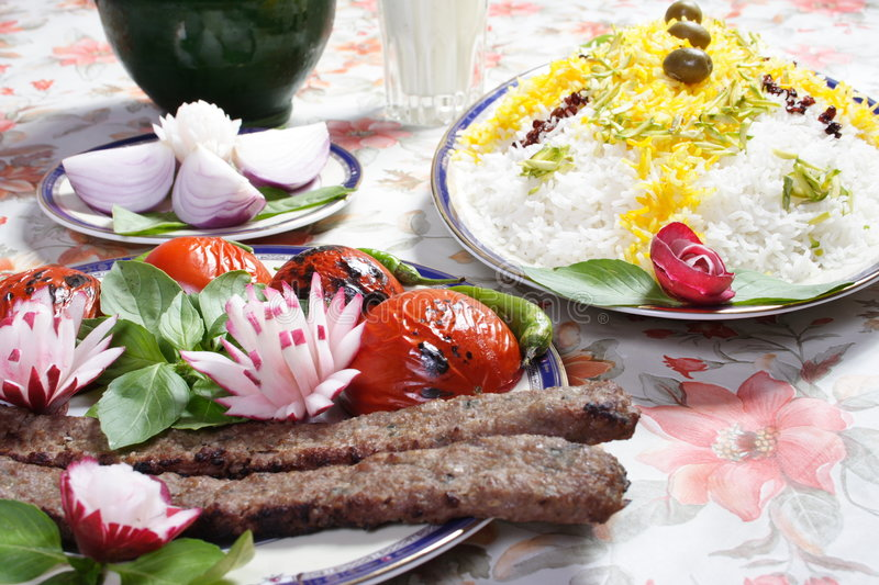 Iran food. Best iran food , rice and roast meat with tomato, yogurt diluted with water royalty free stock images