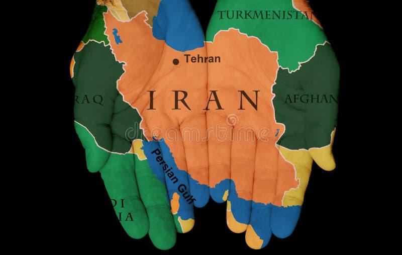 Iran i våra händer royaltyfria foton