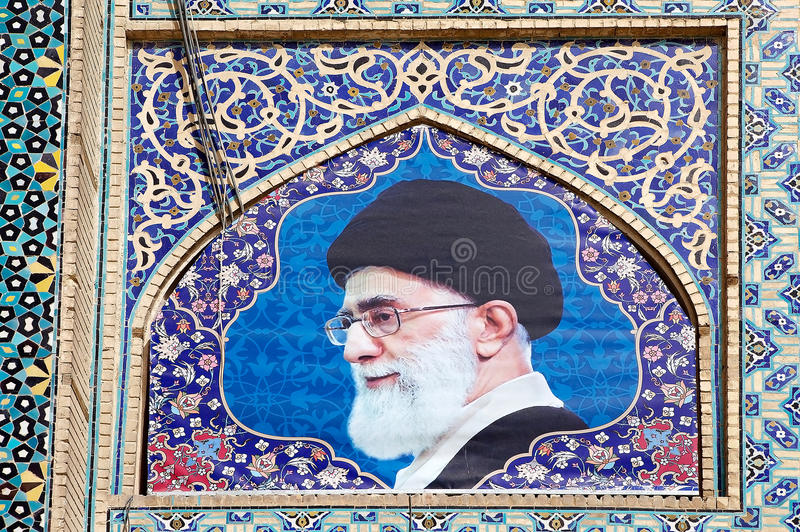 Iran. The picture of the Ayatollah Khamenei, iranian religious and political leader, is on the right side of the West side iwan at the Jameh Mosque of Isfahan royalty free stock images