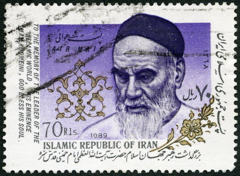 IRAN - 1989: toont Ayatollah Khomeini 1902-1989, Slogan royalty-vrije stock foto's
