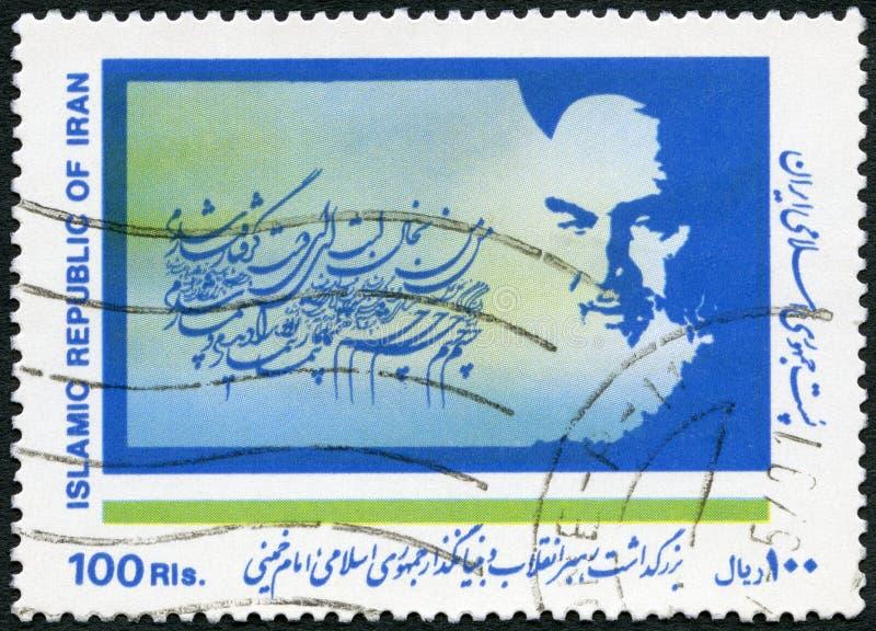IRAN - 1989: toont Portret van Ayatollah Khomeini 1902-1989, Slogan royalty-vrije stock fotografie