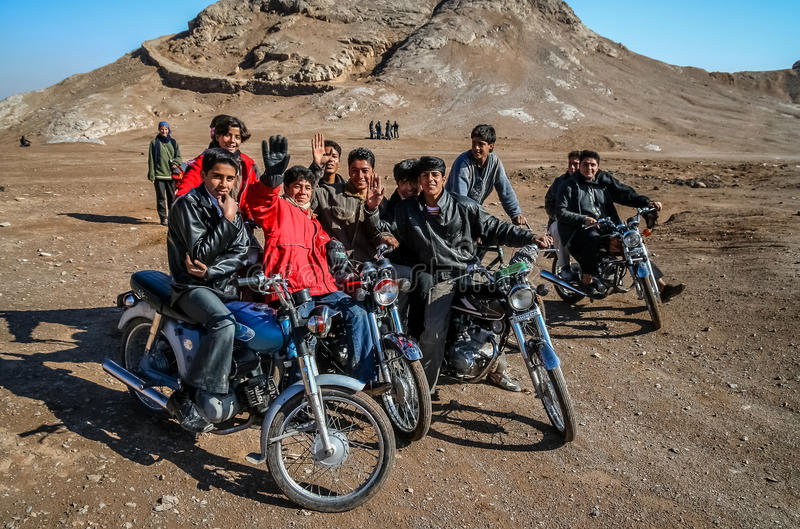 Iranian bikers. Riding on motorcycles near the Towers of Silence in Yazd, southern Iran royalty free stock photos