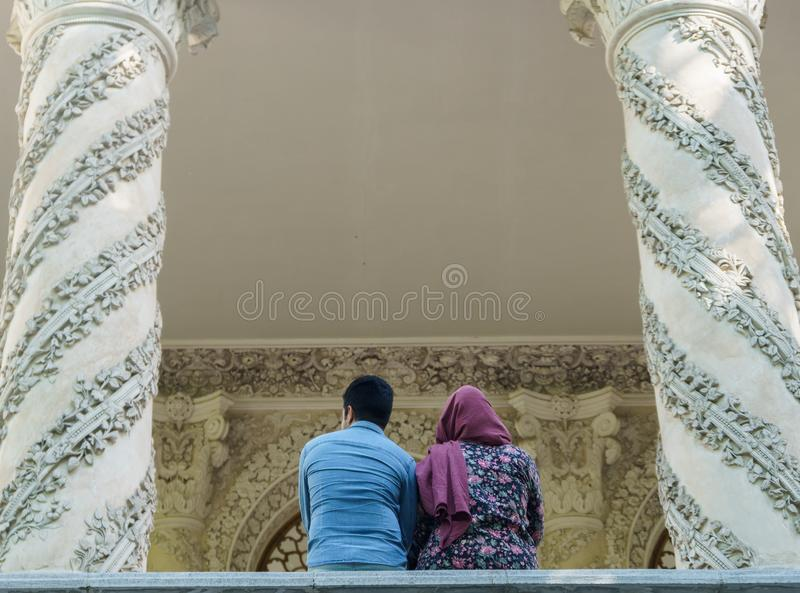 Iranian couple standing near the persian palace in Tehran iran 22 june 2017 royalty free stock image
