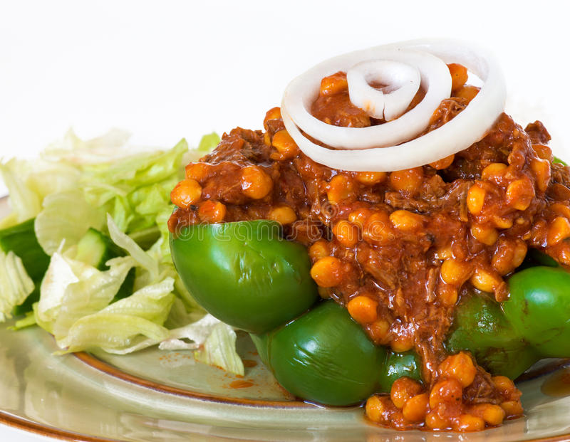 Iranian Cuisine: Khoreshte Ghimeh Ghimeh. Served in a green bell pepper, lettuce salad and white rice royalty free stock image