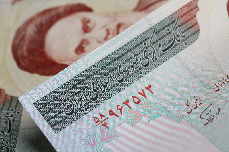 Iranian currency. Iranian rial closeup with some notes in the background royalty free stock images