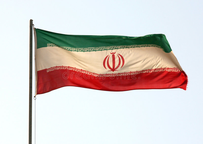 Iranian flag. The Iranian flag. The flying edge has frayed in the wind, otherwise a nice sharp image against the morning sky royalty free stock photos