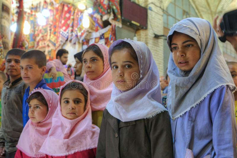 Iranian group of primary school children visited market or Vakil Bazaar. royalty free stock photography