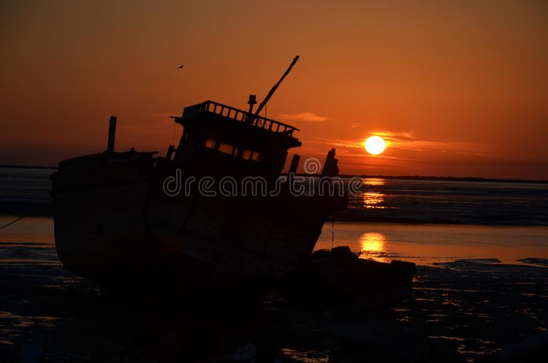 A launch boat in sunset of Persian Gulf royalty free stock images