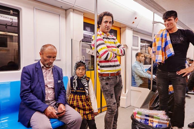 Iranian men and girl ride on subway, Tehran, Iran. stock images
