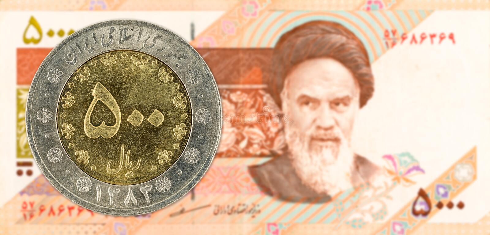 500 iranian rial coin against 5000 iranian rial note obverse. Specimen stock image