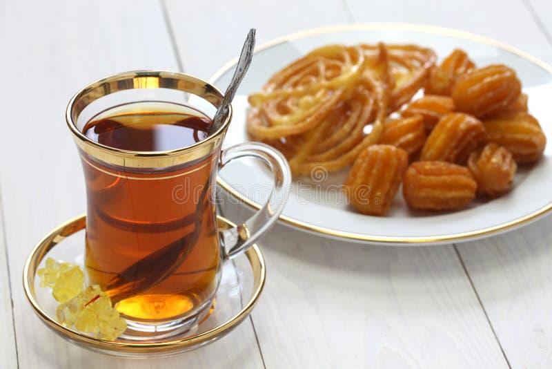Iranian tea and sweets. Zoolbia & bamieh stock photo