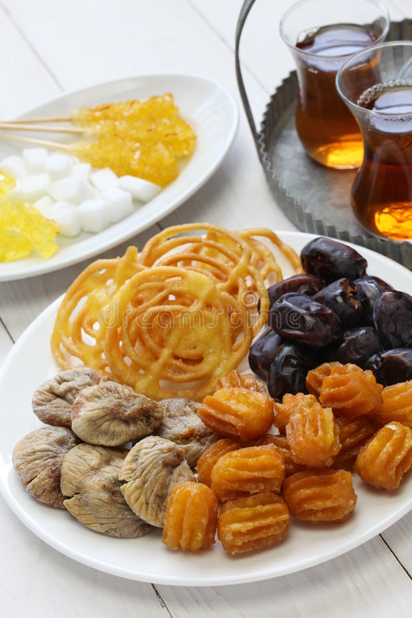 Iranian tea and sweets. Zoolbia, bamieh & dry fruits royalty free stock images