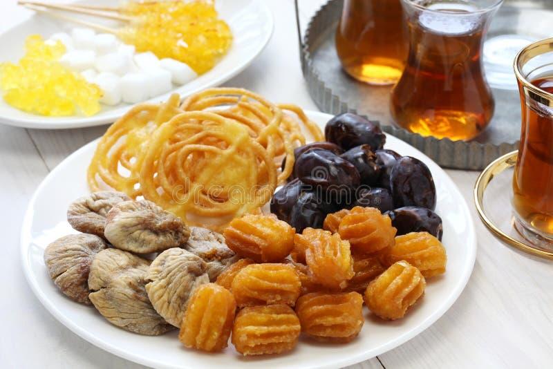 Iranian tea and sweets. Zoolbia, bamieh & dry fruits stock photo