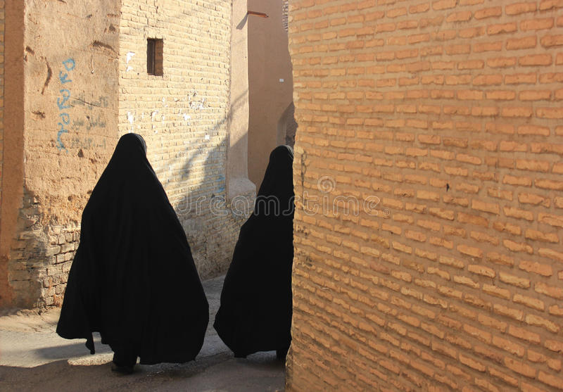 Iranian women on the street. Iranian women in black chador on the street royalty free stock photography