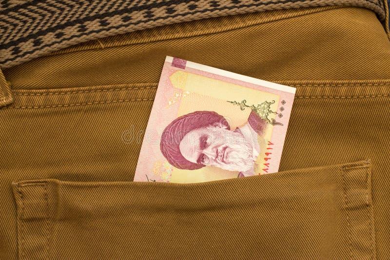 Iranska rials sedlar i fack royaltyfri foto