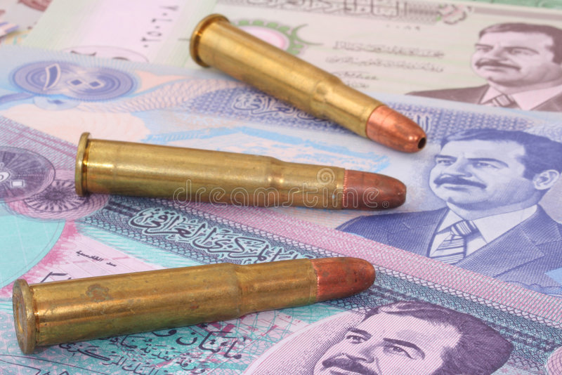 Iraq. Currency From Iraq, With Three Bullets, Shallow DOF, Focus of First Bullet royalty free stock image