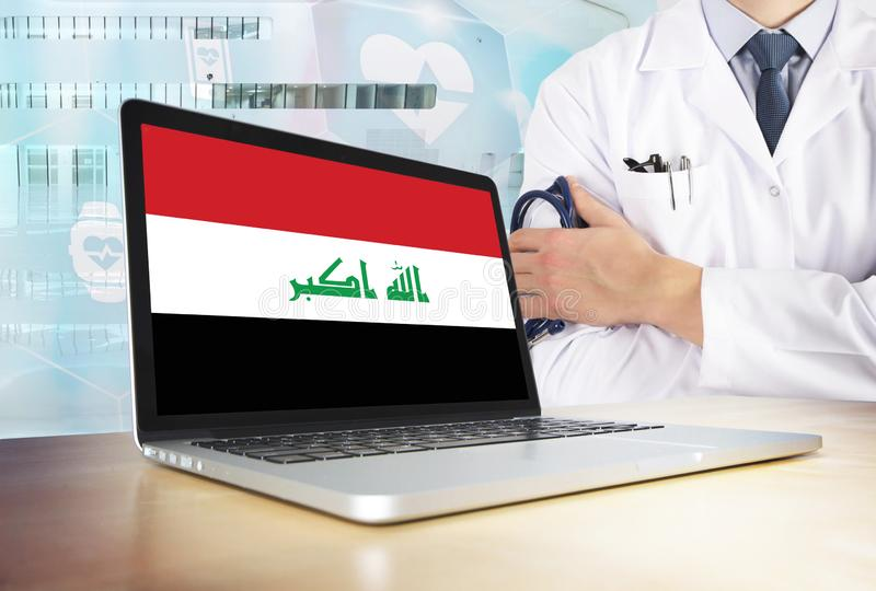 Iraq healthcare system in tech theme. Iraqi flag on computer screen. Doctor standing with stethoscope in hospital. Cryptocurrency. And Blockchain concept stock images