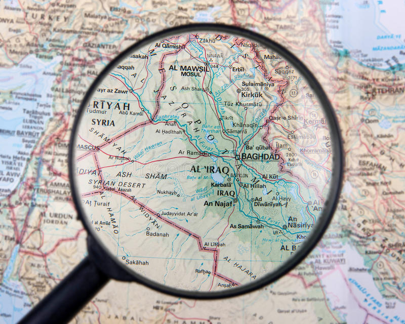 Iraq under magnifier. Iraq map under magnifying glass stock image