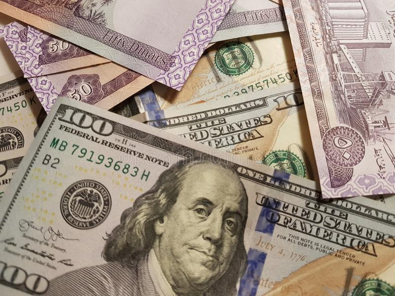 Iraq and the United States Join in the trade and economy, banknotes Use it as a Forex or Financial.  royalty free stock image