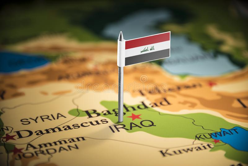 Iraqi marked with a flag on the map royalty free stock photography
