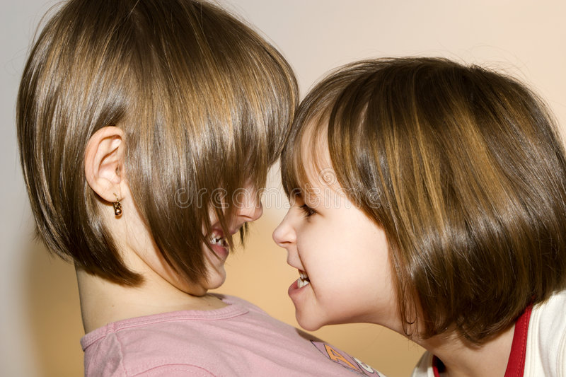 Ire and fun of sisters. Portrait stock photography