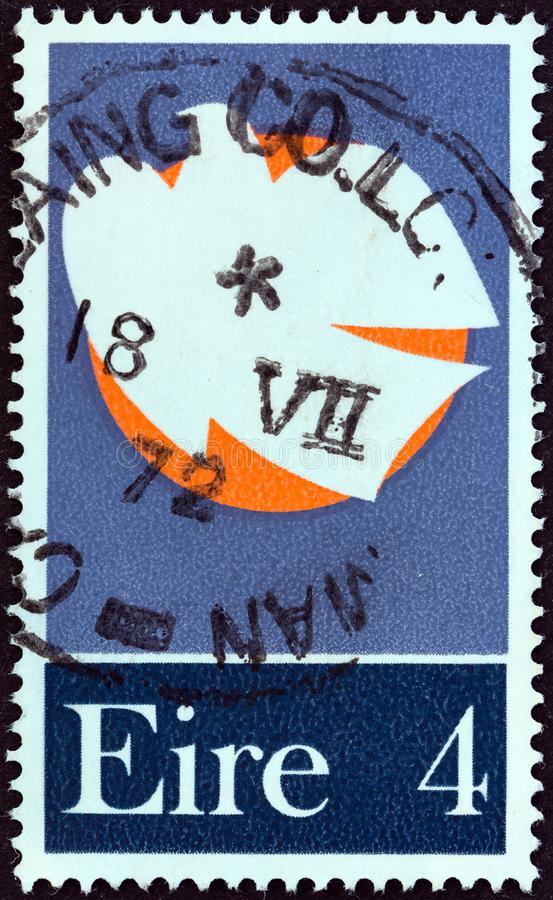 IRELAND - CIRCA 1972: A stamp printed in Ireland issued for the Patriot Dead 1922-1923 shows Dove and Moon, circa 1972. IRELAND - CIRCA 1972: A stamp printed in stock photography