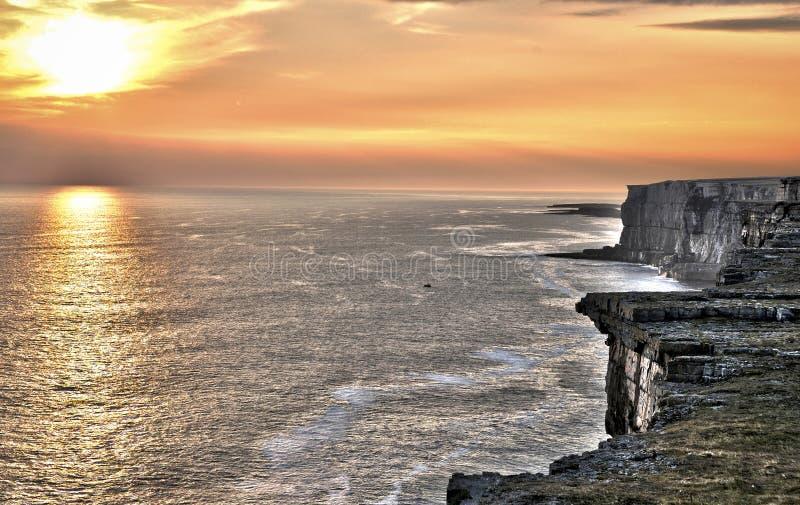 Ireland cliffs at sunset. Aran Islands Inishmore, Ireland. Sunset on the Atlantic Ocean from Inishmore cliff