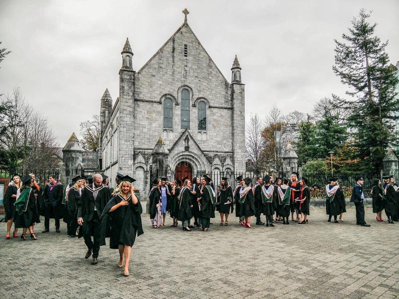 Ireland. Cork. University College of Cork. The UCC. Conferring ceremony. New graduates in the square in front of the splendid Honan Chapel stock photos