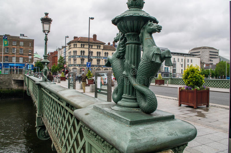 Ireland. Dublin. Grattan Bridge. Detail of a cast iron lampposts decorated with mythological figures of seahorses (hippocampus). Also called Essex Bridge, is a stock photo