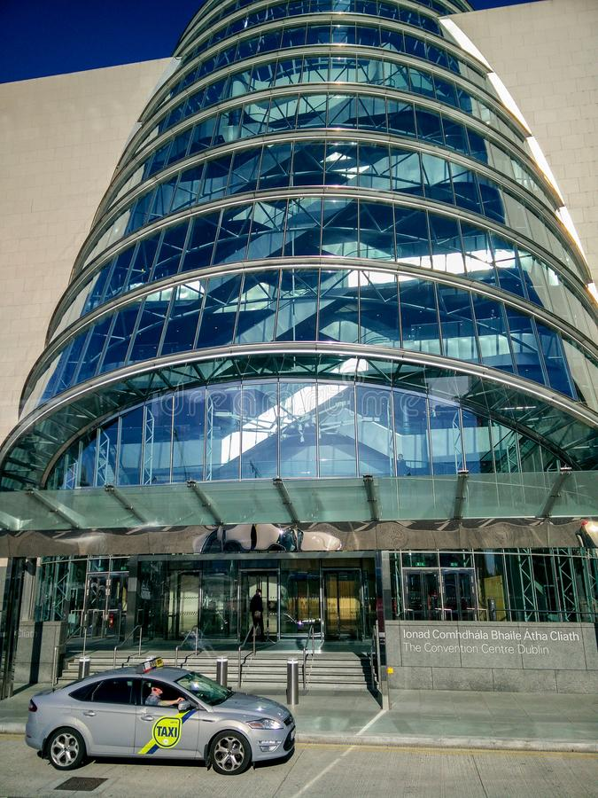 Ireland. Dublin. Modern architecture. Main facade of The Convention Center Dublin with his typical inclined stained glass stock image