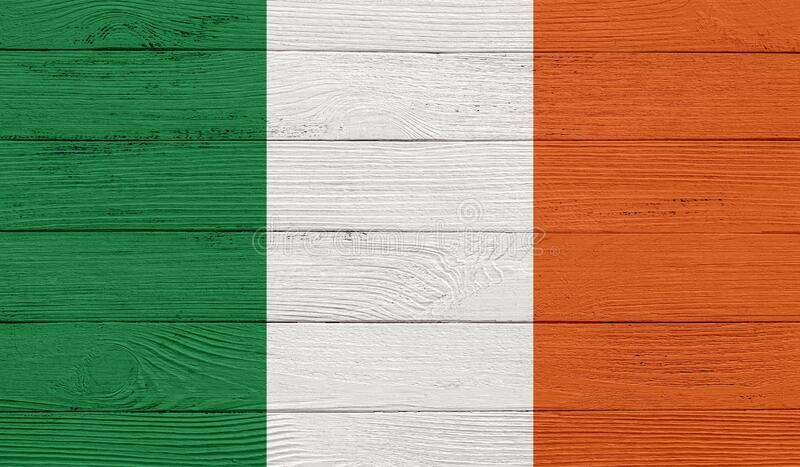 Ireland flag on a wooden texture. Wood texture, planks Wooden texture background flag. Flag painted with paints on wood royalty free illustration