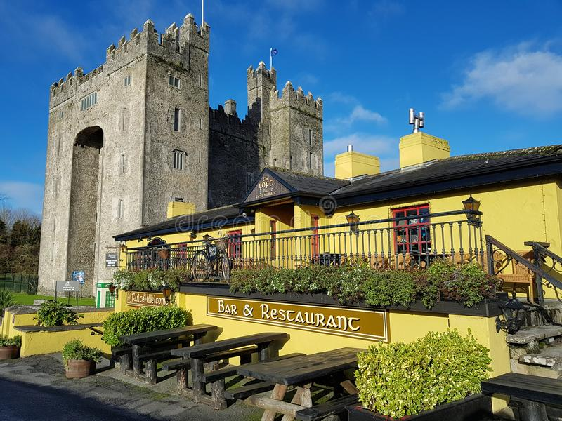 Ireland - Nov 30th 2017: Beautiful view of Ireland`s most famous Castle and Irish Pub in County Clare. Bunratty Castle and Durty Nelly`s Irish Pub, Ireland stock photography