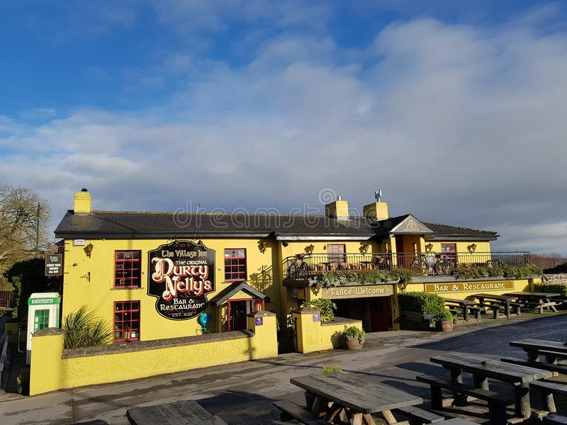 Ireland - Nov 30th 2017: Beautiful view of Ireland`s most famous Castle and Irish Pub in County Clare. Bunratty Castle and Durty Nelly`s Irish Pub, Ireland royalty free stock image