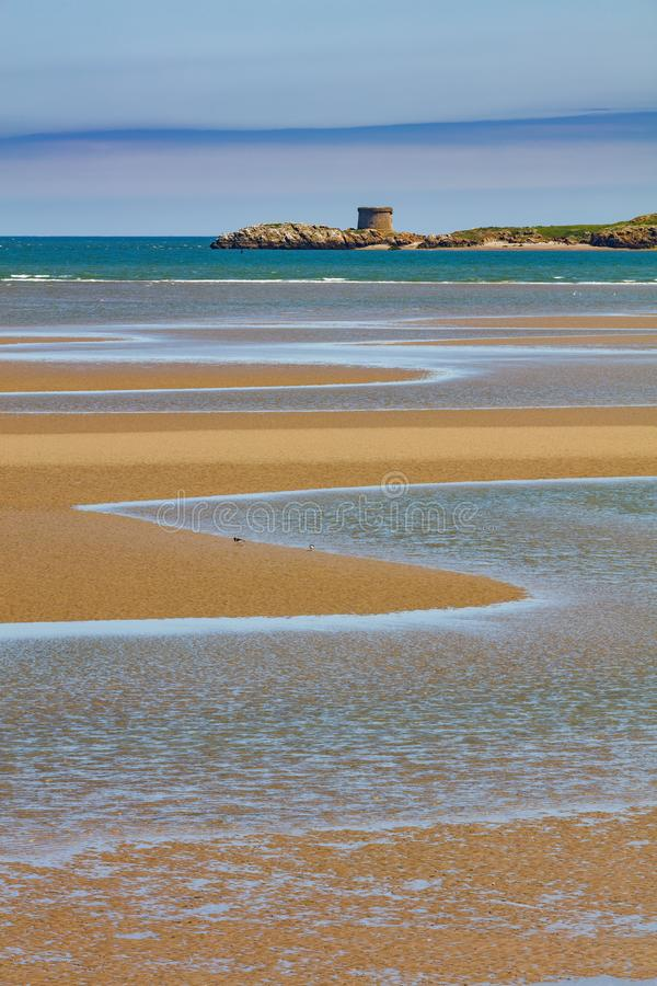 Ireland`s Eye island on the East coast of Ireland. Ireland`s Eye is an island on the East coast of Ireland near Howth as seen from Burrow Beach of Sutton, Dublin royalty free stock image