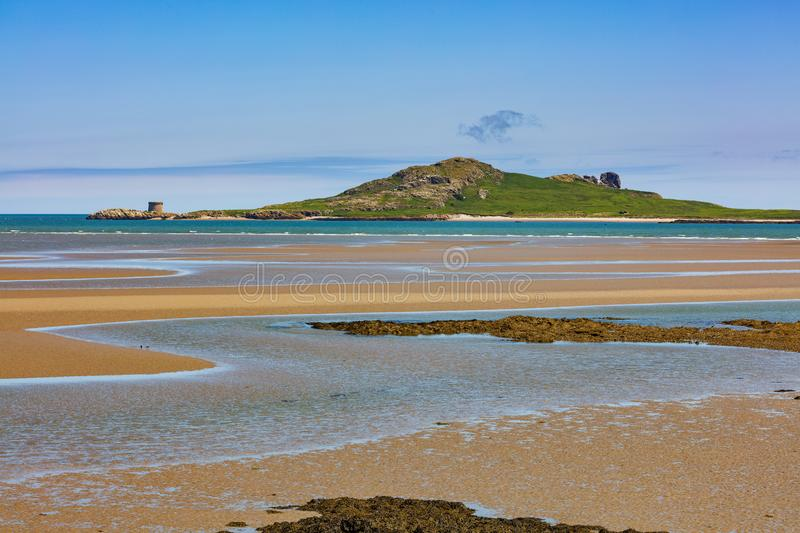 Ireland`s Eye island on the East coast of Ireland. Ireland`s Eye is an island on the East coast of Ireland near Howth as seen from Burrow Beach of Sutton, Dublin stock photo