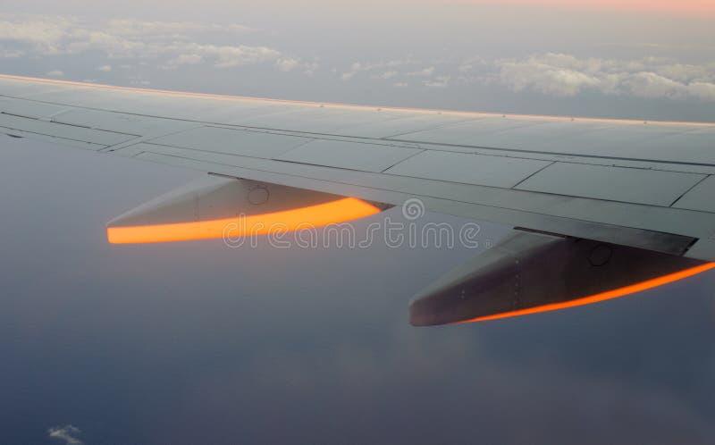Plane during flight on sunset royalty free stock image